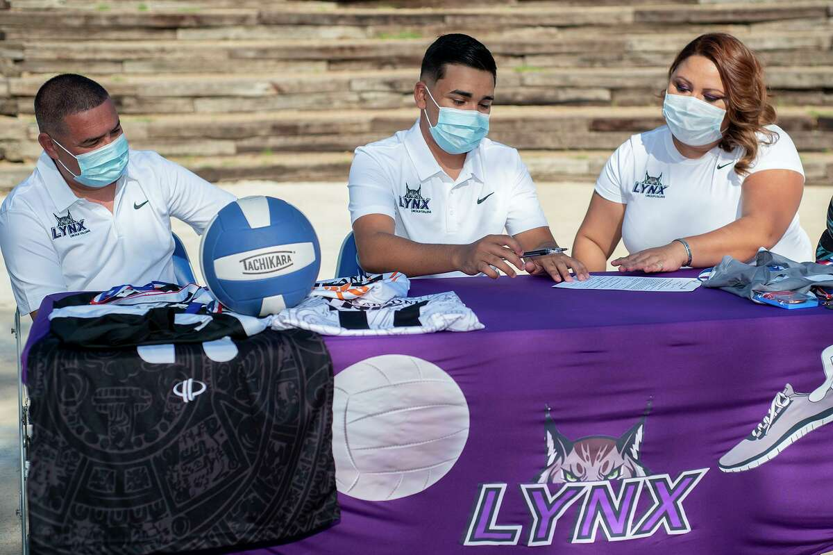 Parents Gerardo Dominguez, left, and Evelyn Dominguez joined their son Jesus Dominguez at the Cigarroa High School Bullring on Thursday, May 6, 2021 as he signed his National Letter of Intent to join the Lincoln College track & field and volleyball teams.