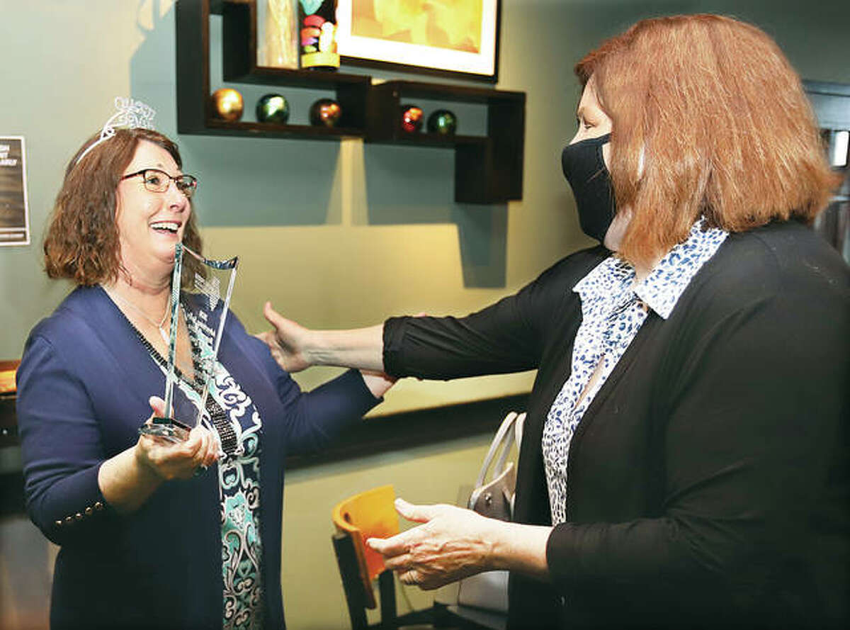 Kimberly Manoogian, left, with The Telegraph, The Edwardsville Intelligencer and The Edge, responds with shock as she recieves the Advertising Sales Representative of the Year Award from Sandy Pistole, Director of Revenue for the Illinois Press Association, at a private ceremony in Edwardsville on April 28. Manoogian was honored Friday during the IPA's virtual convention.