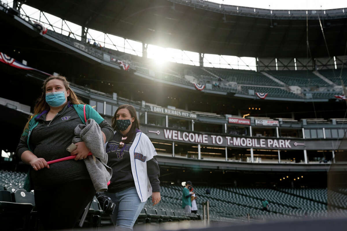 Fans take their seats before the game between the Seattle Mariners and the San Francisco Giants at T-Mobile Park on April 02, 2021 in Seattle, Washington.