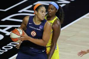 The Connecticut Sun's Brionna Jones, left, is defended by the Chicago Sky's Cheyenne Parker during a WNBA game last season.