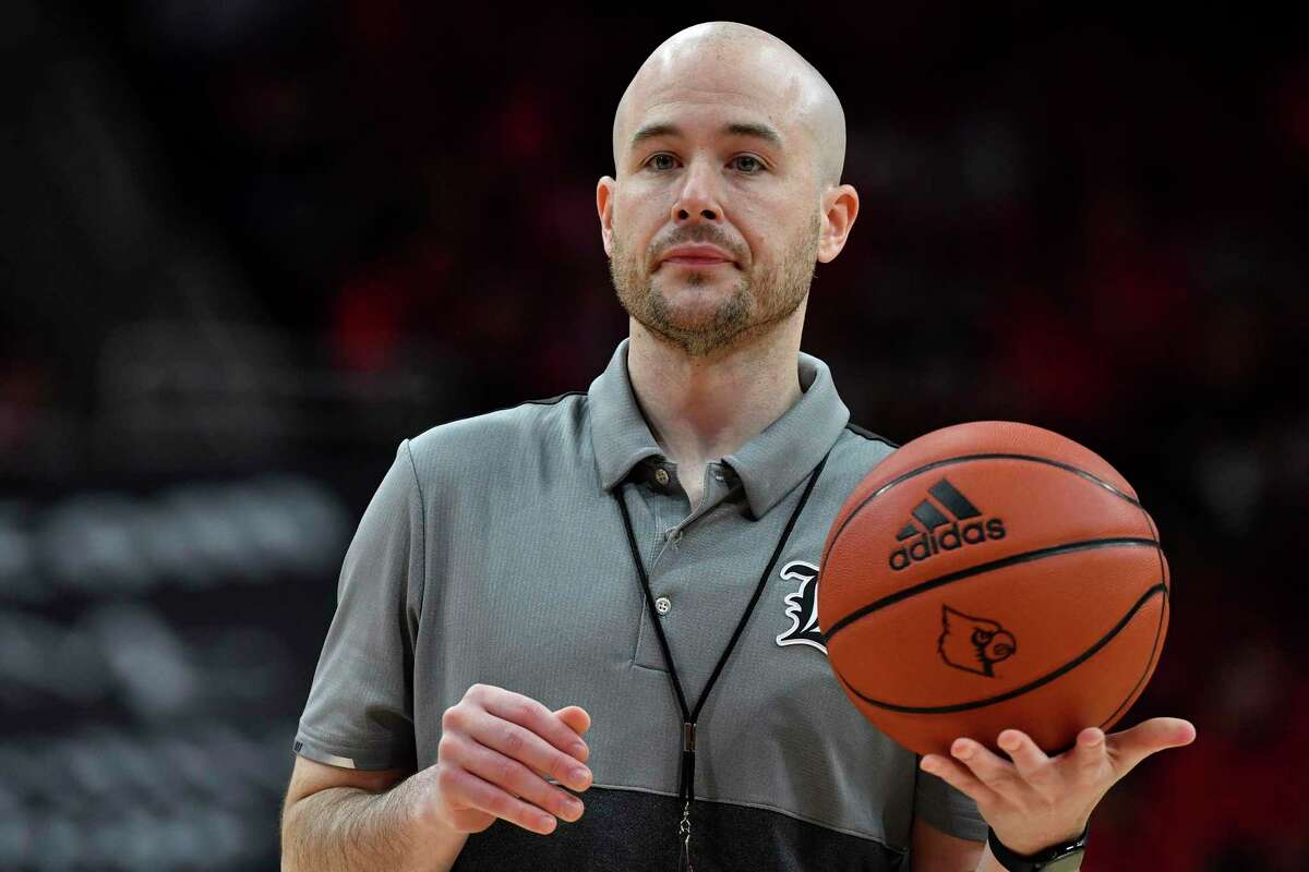UConn assistant coach Luke Murray, shown here with Louisville, says he has always had a passion for recruiting.