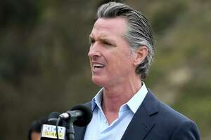 FILE - In this April 23, 2021, file photo, California Gov. Gavin Newsom speaks during a press conference in Big Sur, Calif. The state's population has become a political issue this year in light of the effort to recall Newsom, with Republicans blaming high taxes and the governor's policies for people fleeing the state.