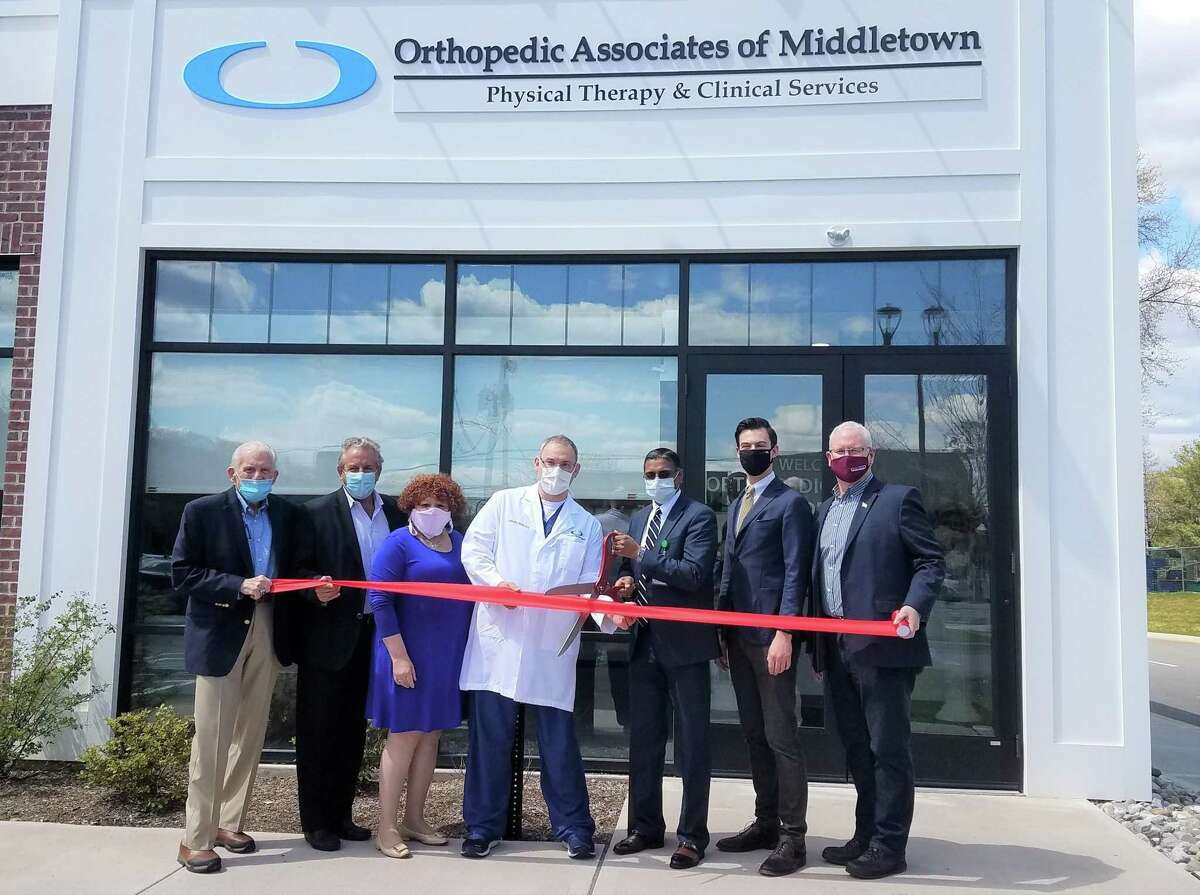 Orthopedic Associates of Middletown celebrated a grand opening April 19. From left are Middlesex County Chamber of Commerce President Larry McHugh, President of Kempenaar Real Estate Inc. Rocky Kempenaar II, Central Business Bureau Chairwoman Pamela Steele, Alfred K. Hicks, D.O., Vice President of Operations Roy Sasenaraine, Mayor Ben Florsheim, and Chamber Chairman Tom Byrne.