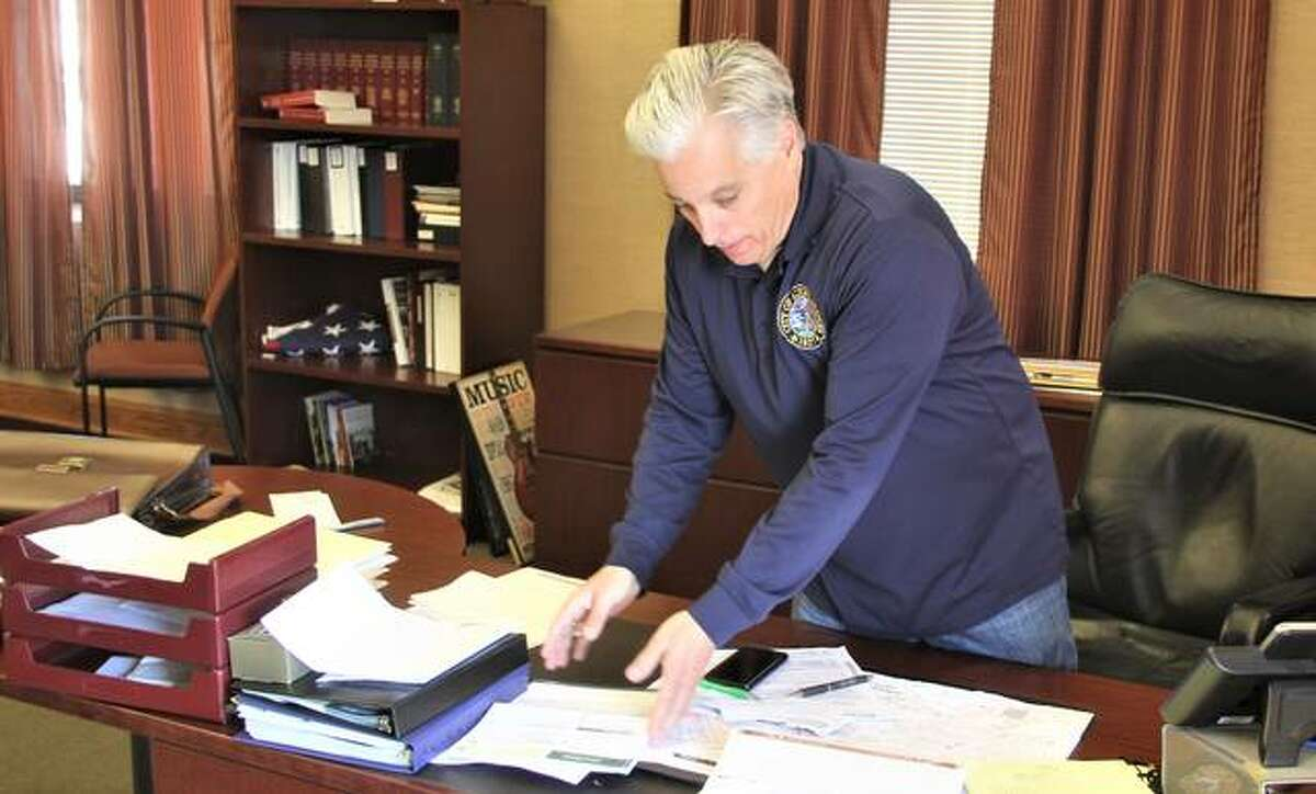 Alton Mayor Brant Walker cleans his desk Friday as he prepares to leave the office he was elected to in 2013. Next week David Goins will take over the desk. Goins defeated Walker in the April 6 election.