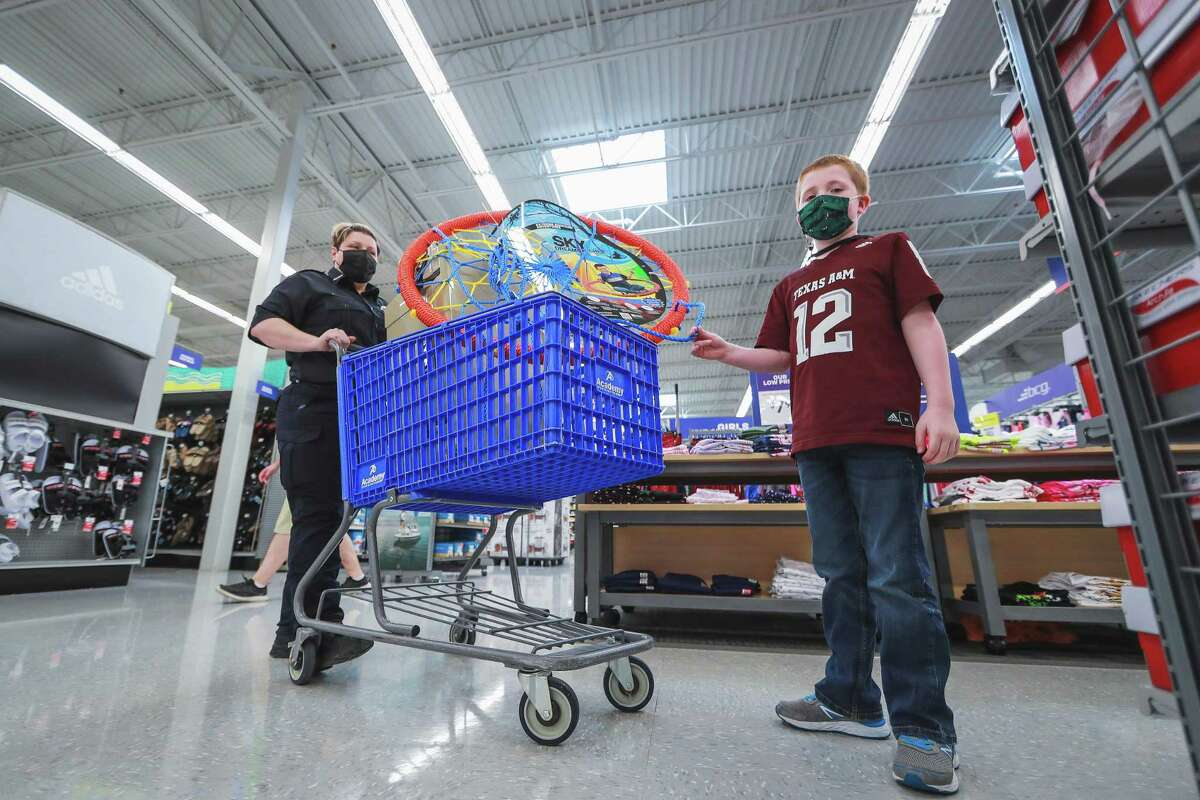 AEMT Khristina Smith was helped out in the shopping spree from her capable son Grayson, sporting a Texas A&Mt-shirt.Smith and four of her colleagues were surprised by a shopping spree from Academy on Tuesday, May 4.