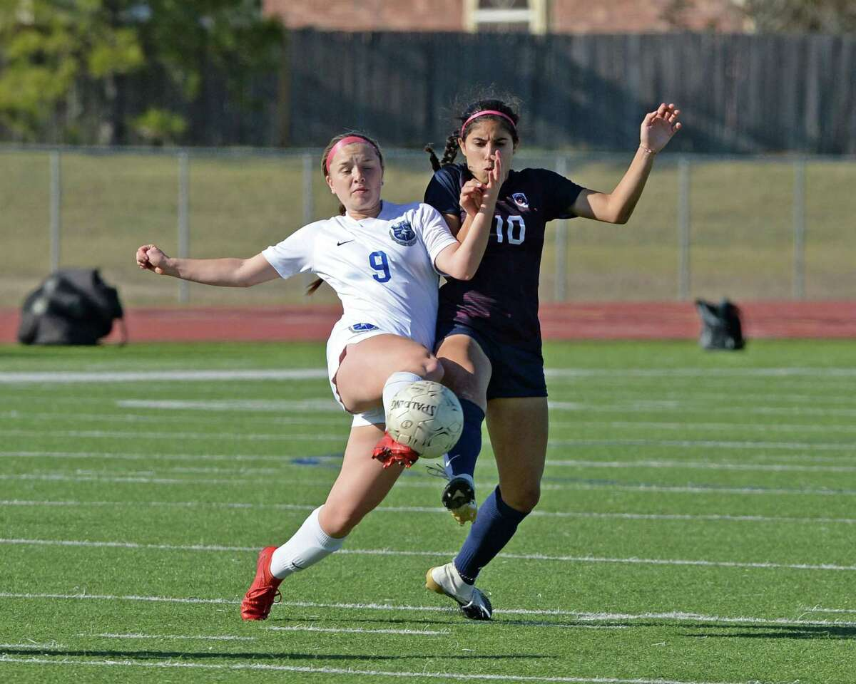 Sara Chamberlain (9) of Clear Springs and Gabriela Rodriguez (10) of Tompkins compete for a ball during the second half of the girls soccer game between the Tompkins Falcons and the Clear Springs Chargers in the I-10 Shootout on Thursday, January 14, 2021 at Tompkins High School, Katy, TX.