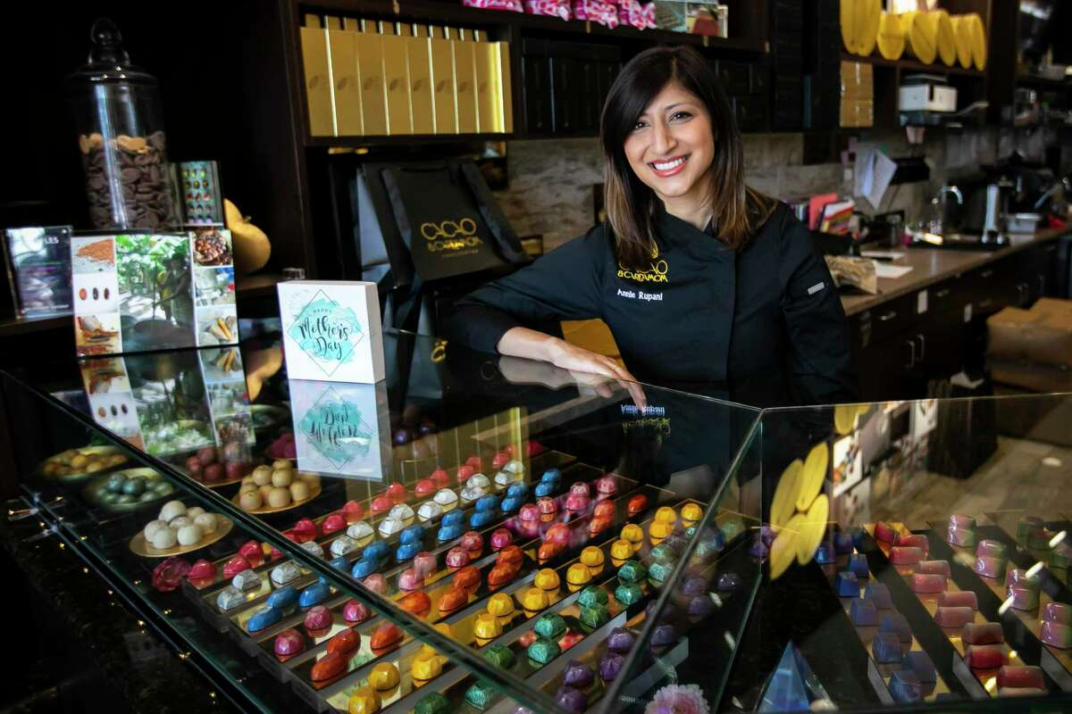 Chocolatier Annie Rupani-Farino in the Westheimer location of her chocolate shop, Cacao & Cardamom, on Friday, May 7, 2021. Rupani-Farino has created a beautiful Mother's Day gemstone botanical chocolate collection for mothers in Houston while celebrating her own first Mother's Day with her 2.5 month old daughter.
