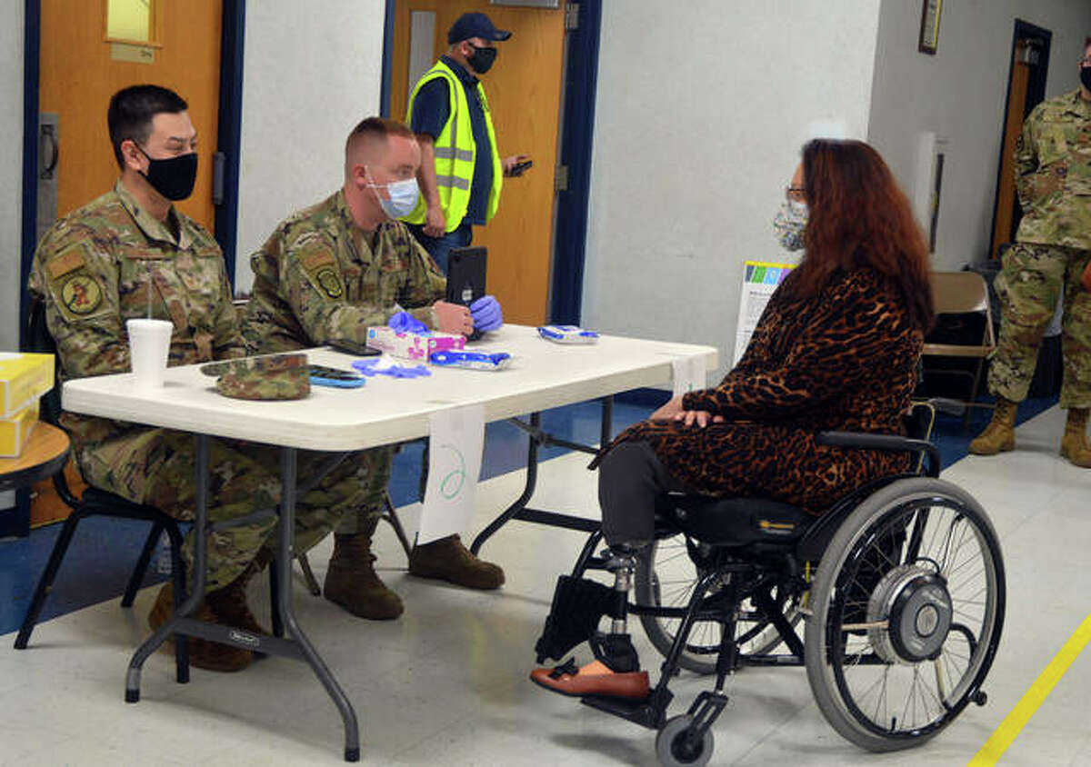 U.S. Sen. Tammy Duckworth, right, meets with two members of the Illinois National Guard on Friday during a COVID-19 vaccine clinic at Edwardsville American Legion Post 199.