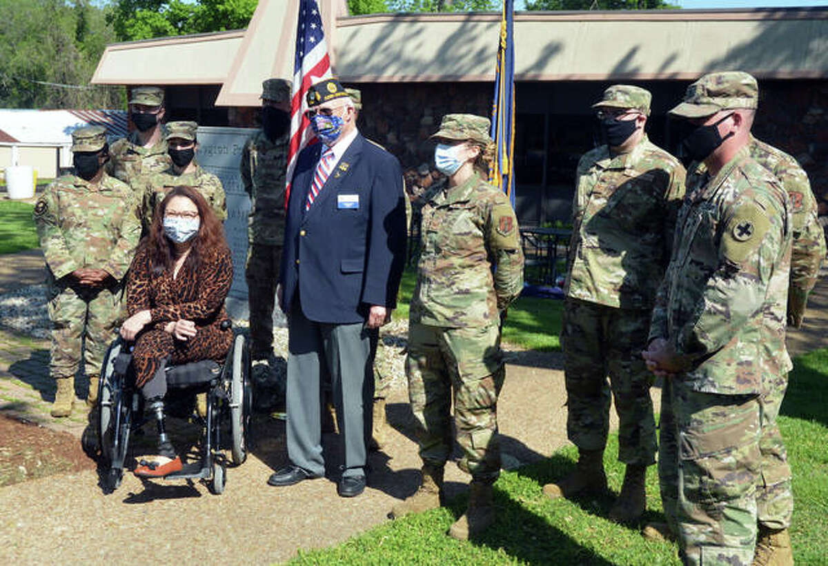 FILE - U.S. Sen. Tammy Duckworth poses for a photo with members of the Illinois National Guard during a COVID-19 vaccine clinic at Edwardsville American Legion Post 199.