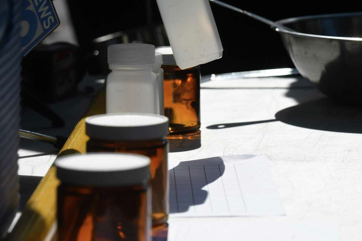 FILE PHOTO: Containers used to collect soil and water samples to detect for PFAS from the Norlite aggregate plant are displayed during a New York State Department of Conservation press conference. The owners of two private wells in Killingworth were told not to use water for cooking or drinking after tests showed