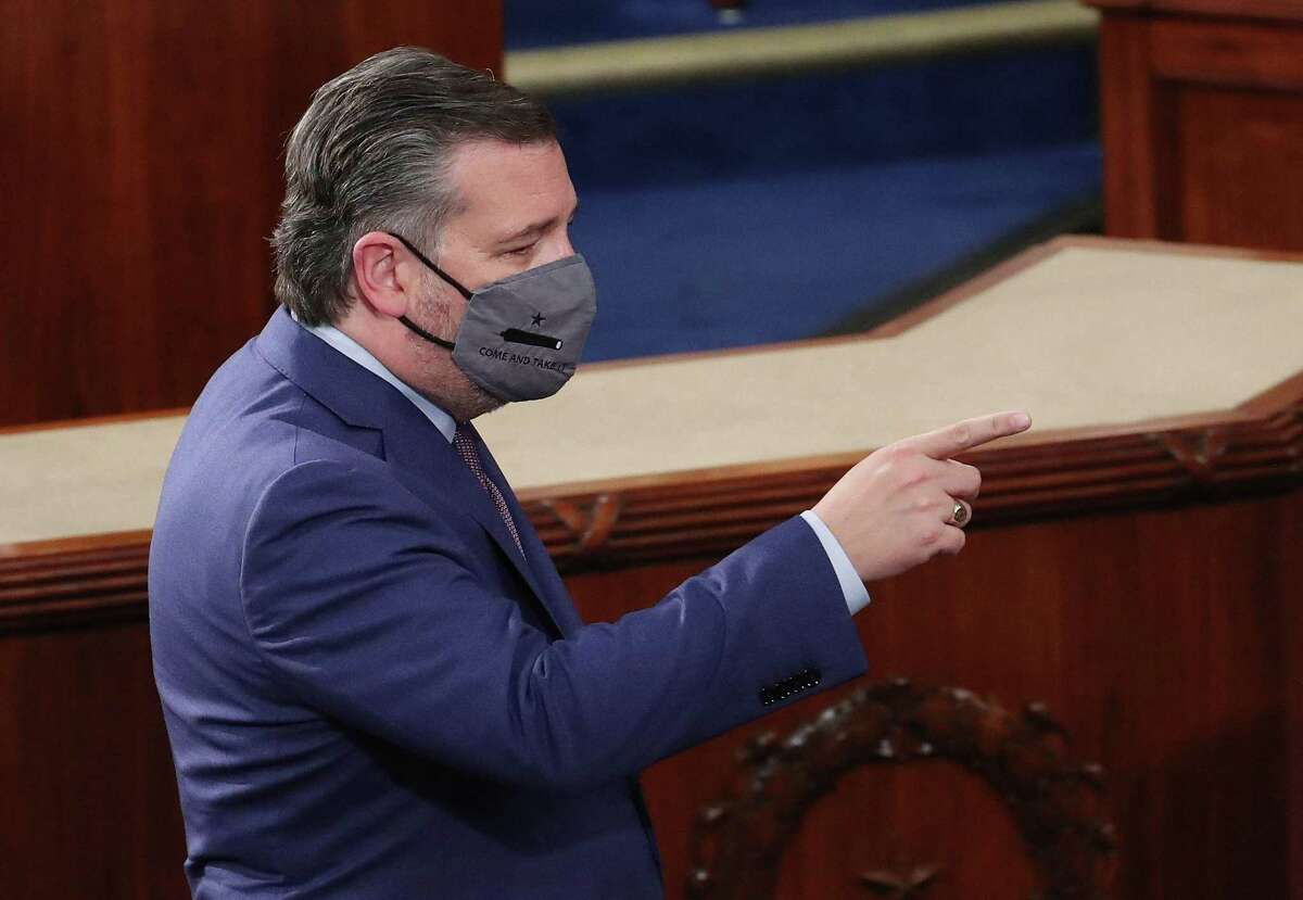 Republican Senator Ted Cruz of Texas wears a face mask as he gestures before US President Joe Biden arrives to deliver his first address to a joint session of Congress at the US Capitol in Washington, DC, on April 28, 2021. (Photo by MICHAEL REYNOLDS / POOL / AFP) (Photo by MICHAEL REYNOLDS/POOL/AFP via Getty Images)