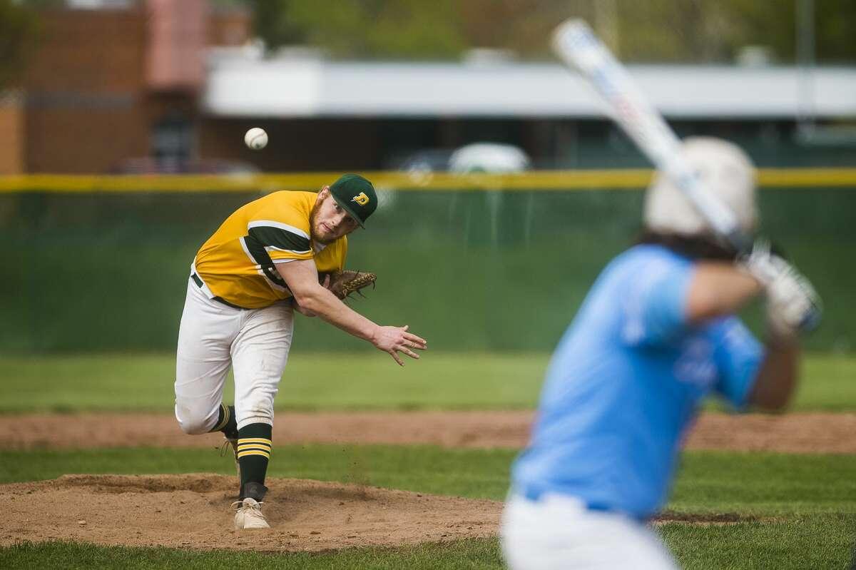 Dow's Caleb Brenske pitches the ball during a game against Essexville Garber Friday, May 7, 2021 at H. H. Dow High School. (Katy Kildee/kkildee@mdn.net)