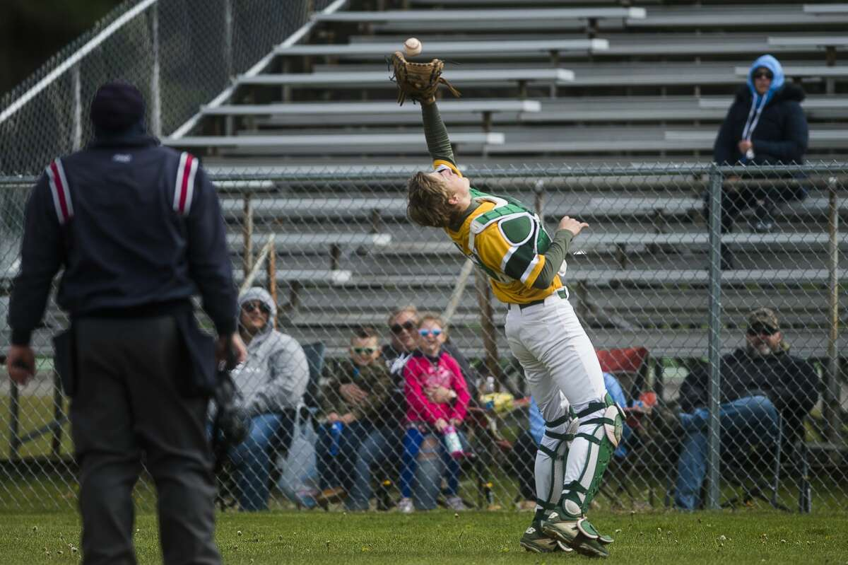 Dow's Tom Bacigalupo catches a fly ball during a game against Essexville Garber Friday, May 7, 2021 at H. H. Dow High School. (Katy Kildee/kkildee@mdn.net)