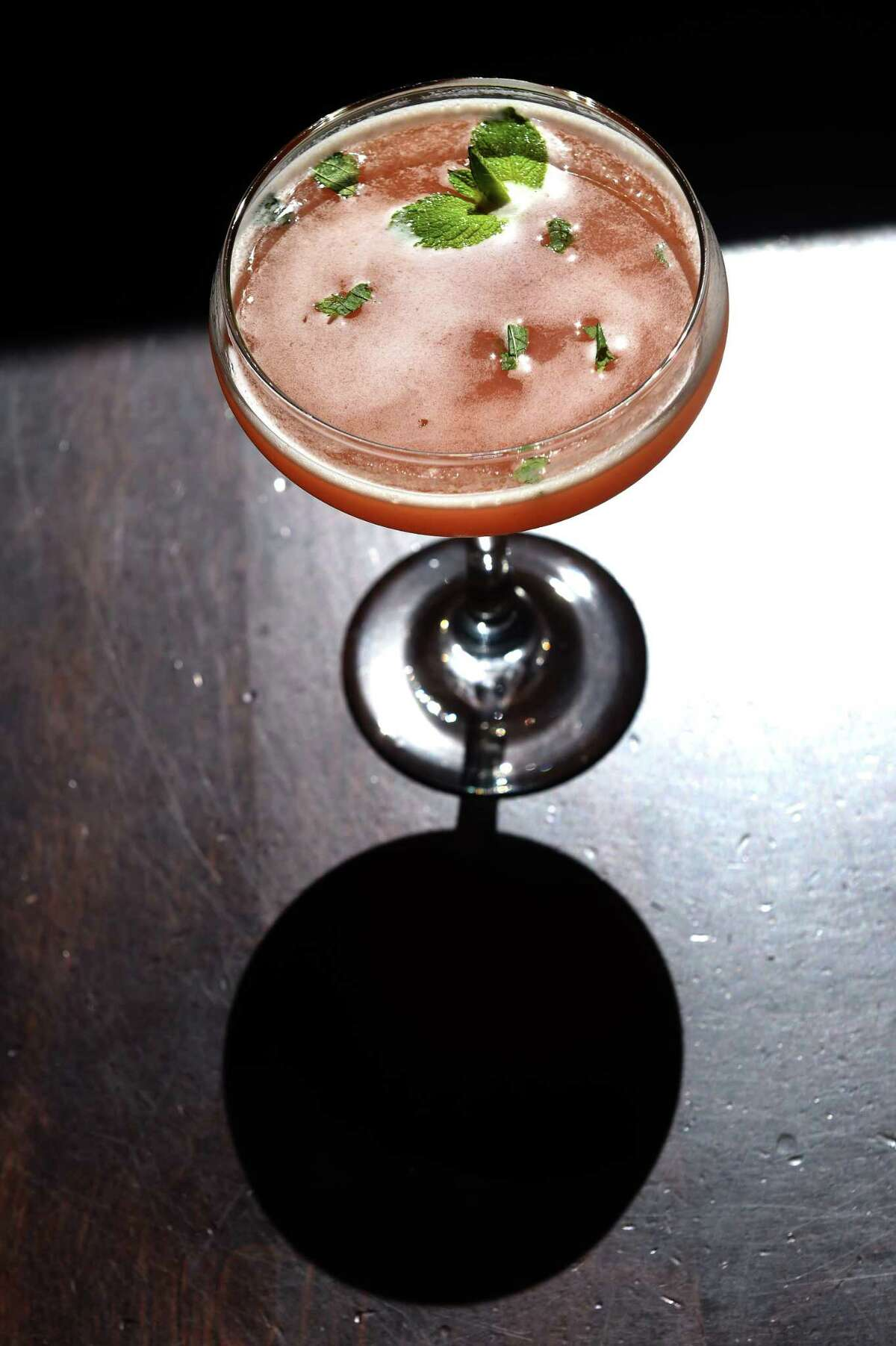 New Haven's Prime 16 signature craft cocktail, Grapefruit Classico, containing vodka, grapefruit juice fresh mint and a dash of lime.