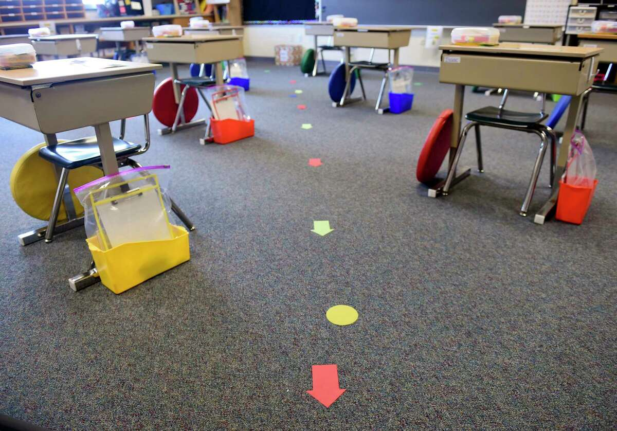 In a first grade classroom where the desks have been spread out for social distancing, and there are marks on the floor to indicate where the students should stand when lining up. At Shiloh Hills Elementary School, part of the Wilson School District in Spring Township, Pennsylvania, Friday afternoon Aug. 21, 2020 where school teachers and administrators are preparing to open on Aug. 26 for the school year after being closed since spring as a precaution against the COVID-19/Coronavirus outbreak. (Photo by Ben Hasty/MediaNews Group/Reading Eagle via Getty Images)