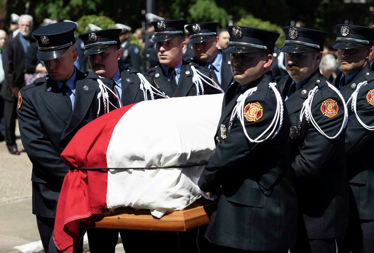 Firefighters carry the casket of retired Conroe firefighter Lt. Neal Radford after a funeral service at First Methodist Conroe, Friday, May 7, 2021, in Conroe. Radford died April 29 after a near month-long ICU battle with COVID-19.