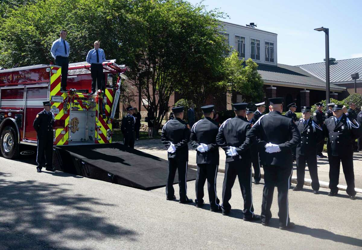 First responders lineup outside as they await retired Conroe firefighter Lt. Neal Radford's casket to be transported to the burial grounds during a funeral service at First Methodist Conroe, Friday, May 7, 2021, in Conroe. Radford died April 29 after a near month-long ICU battle with COVID-19.