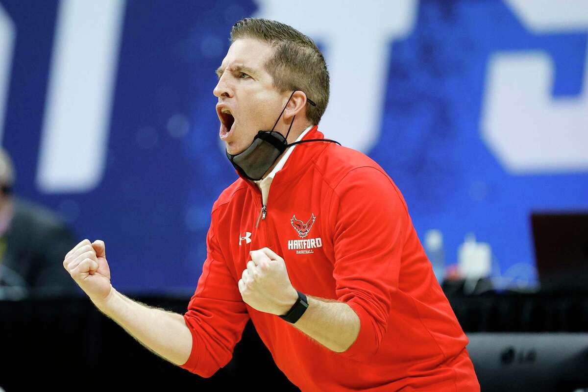 INDIANAPOLIS, INDIANA - MARCH 19: Head coach John Gallagher of the Hartford Hawks reacts during their game against the Baylor Bears in the first round of the 2021 NCAA Men's Basketball Tournament at Lucas Oil Stadium on March 19, 2021 in Indianapolis, Indiana. (Photo by Tim Nwachukwu/Getty Images)
