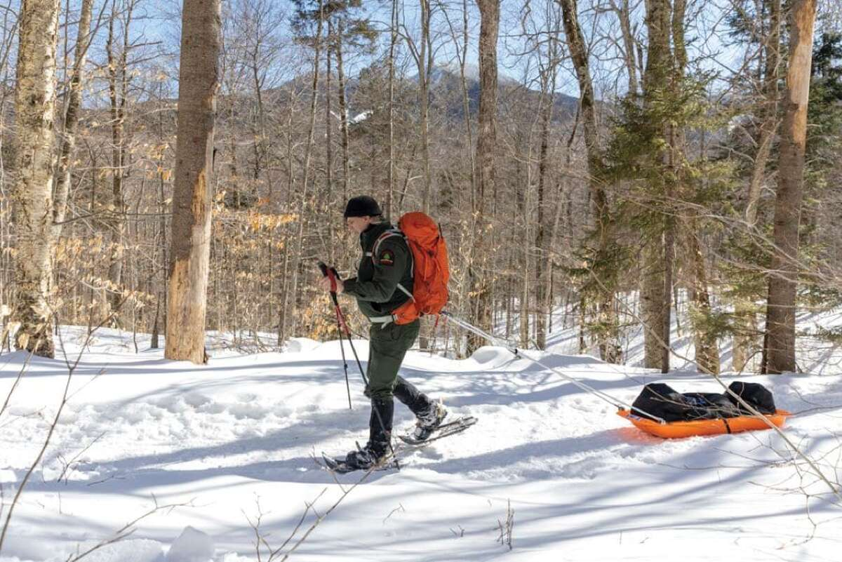 Forest Ranger Scott van Laer pulls a sled with his belonging after visiting the Johns Brook Valley outpost in early March. (Mike Lynch/Adirondack Explorer)