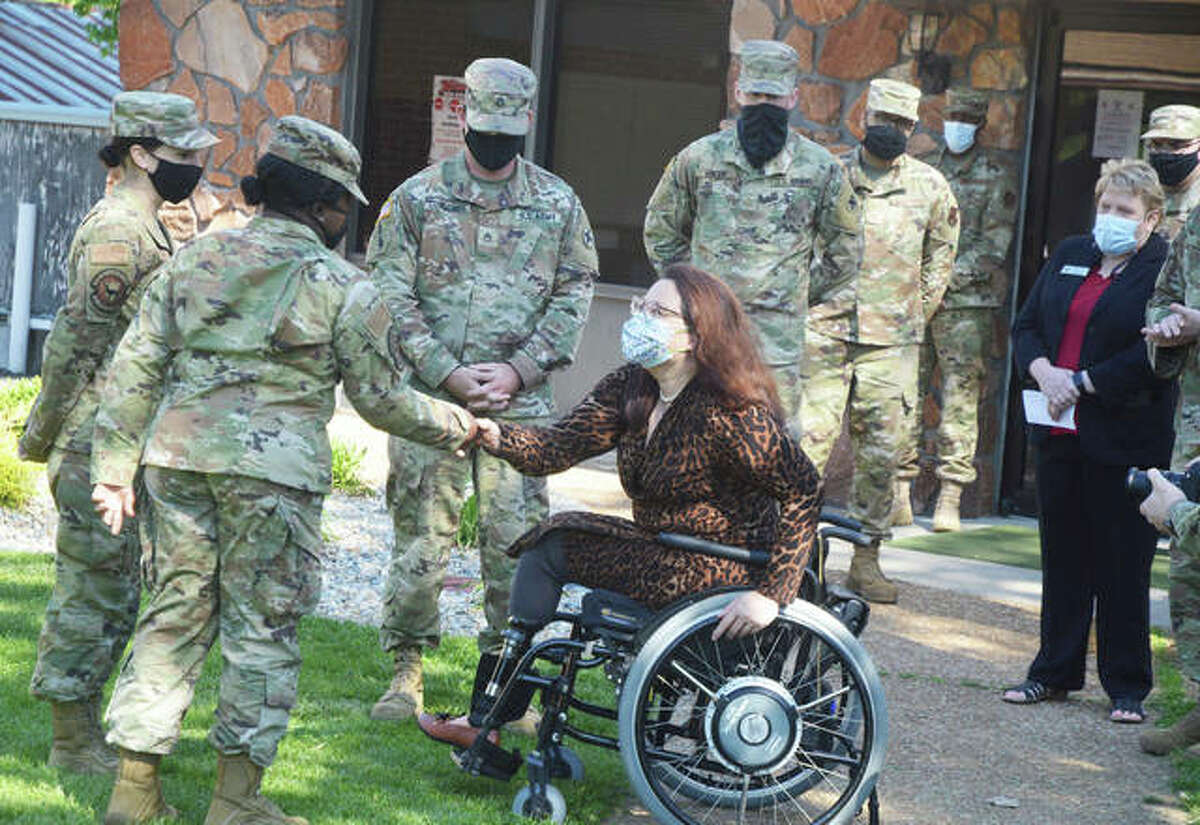 U.S. Sen. Tammy Duckworth, right, meets members of the Illinois National Guard Friday morning during a COVID-19 vaccine clinic at Edwardsville American Legion Post 199.