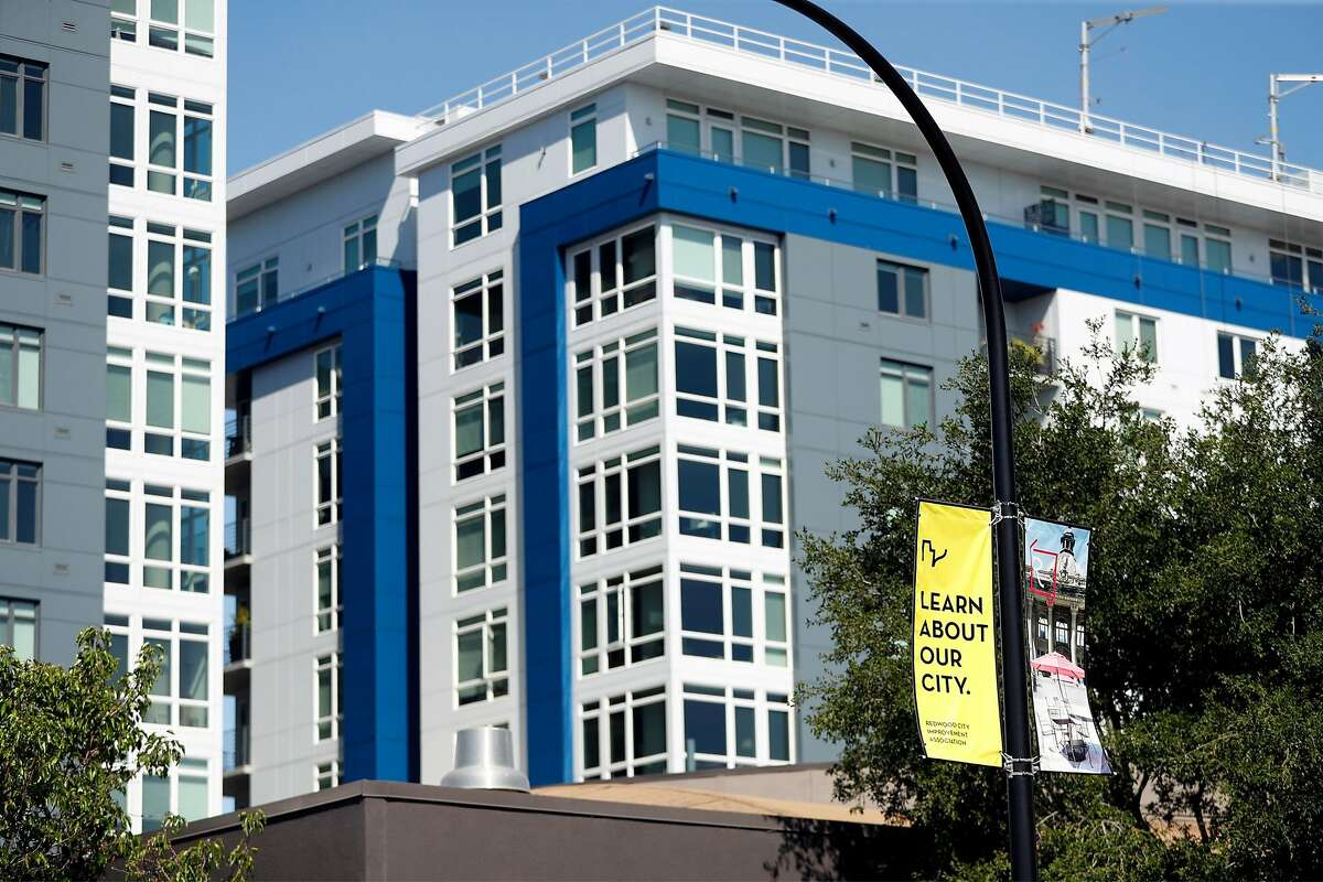 The proliferation of new apartments in downtown Redwood City, like Indigo Luxury Apartments and Penthouses, is a stark contrast to other Peninsula cities, where single-family home zoning and anti-development politics have combined to exacerbate a housing shortage.