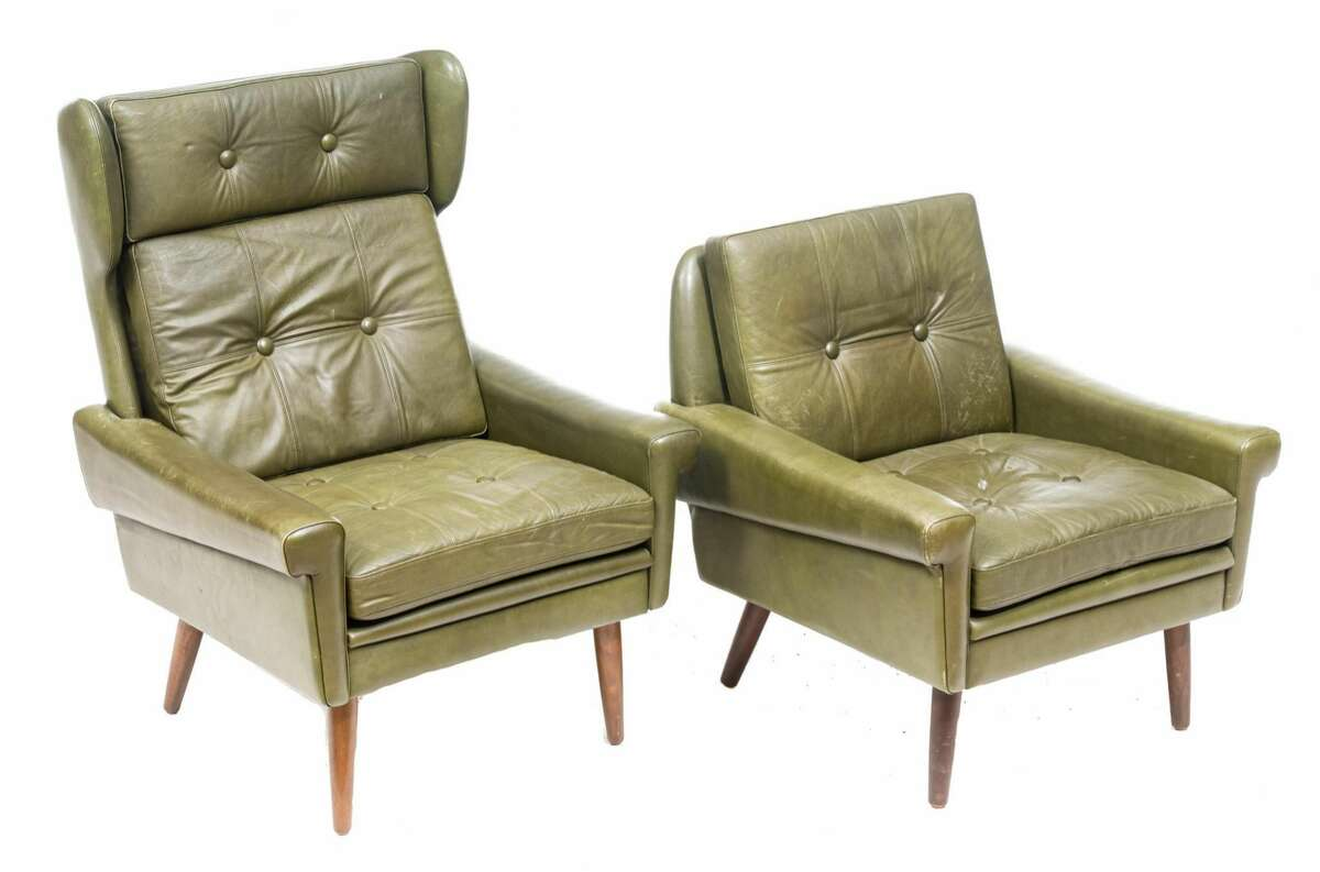 Lovely green complementary leather arm chairs These chairs say