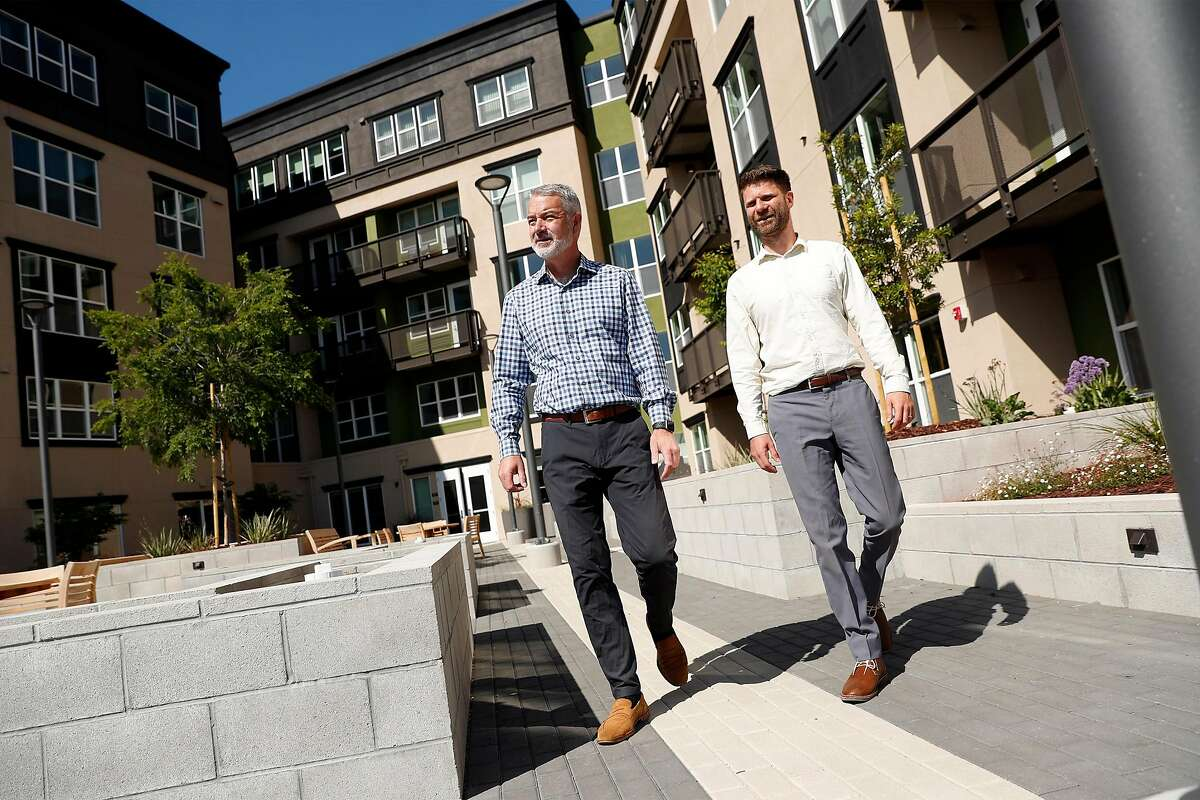 MidPen Housing's Matt Franklin and Andrew Bielak at Arroyo Green, an affordable senior housing development are walking in downtown Redwood City, which has seen several housing projects come to life in recent years.