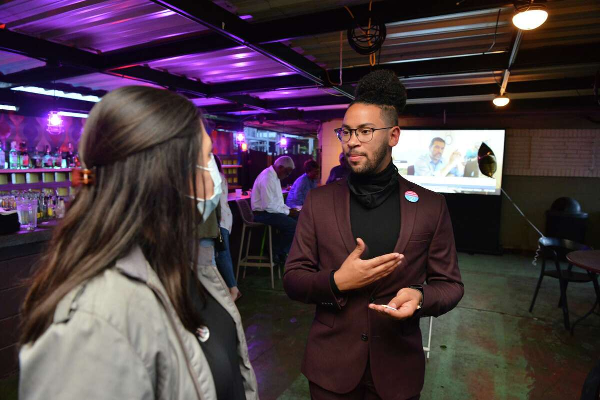 Jalen McKee Rodriguez speaks with supporters at Tucker's Kozy Corner Saturday evening following the election.