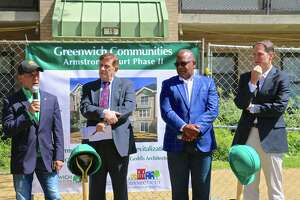 From left, First Selectman Fred Camillo, Greenwich Community Board of Commissioners Chair Sam Romeo, Greenwich Communities Executive Director Anthony Johnson and U.S. Rep. Jim Himes all are on hand for the official groundbreaking of Phase II of the Armstrong Court improvement project on May 1.