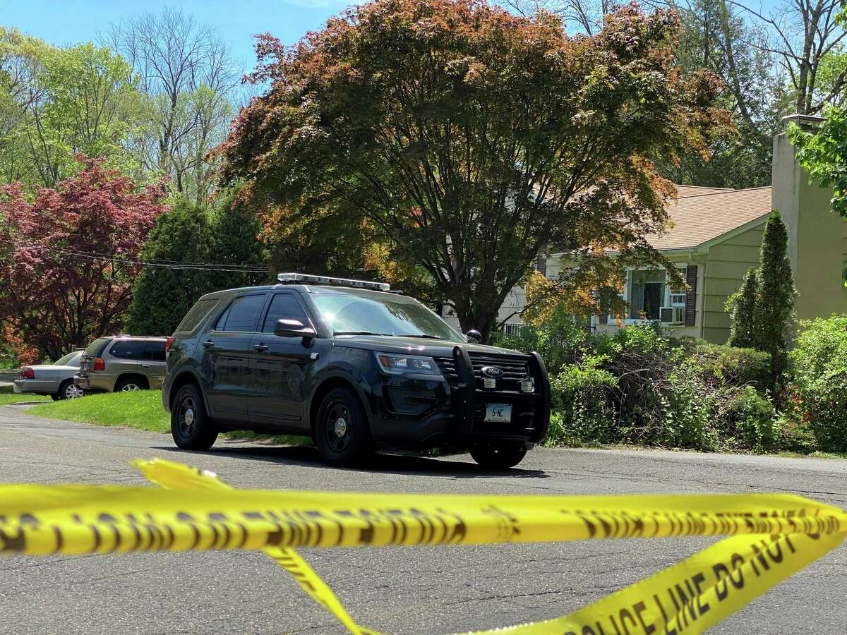 This is the home of Albert Kokoth on Down River Road, where a police car can be seen and caution tape is draped across the road. Kokoth was detained in New Canaan jail after he was arrested on Thursday for charges including second degree assault and illegal discharge of a firearm related to his wife Margaret's death.