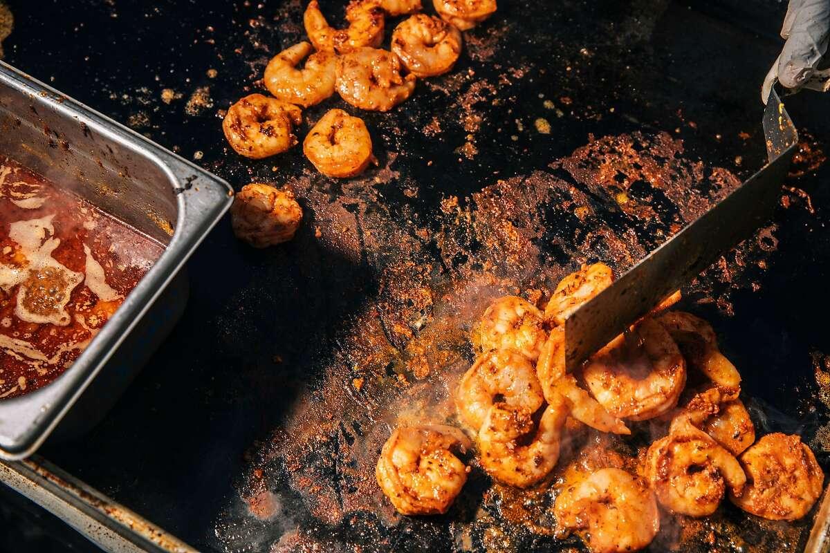 Gumbo Social griddles shrimp for its shrimp po'boy.
