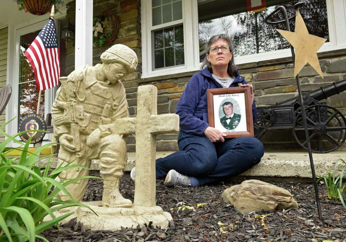 American Gold Star mother Carrie Farley sits in front of her home next to a memorial statue on Friday, May 7, 2021 in East Greenbush, N.Y. Her son SSG Derrick J. Farley died in Afghanistan in 2010 while detonating a bomb.(Lori Van Buren/Times Union)