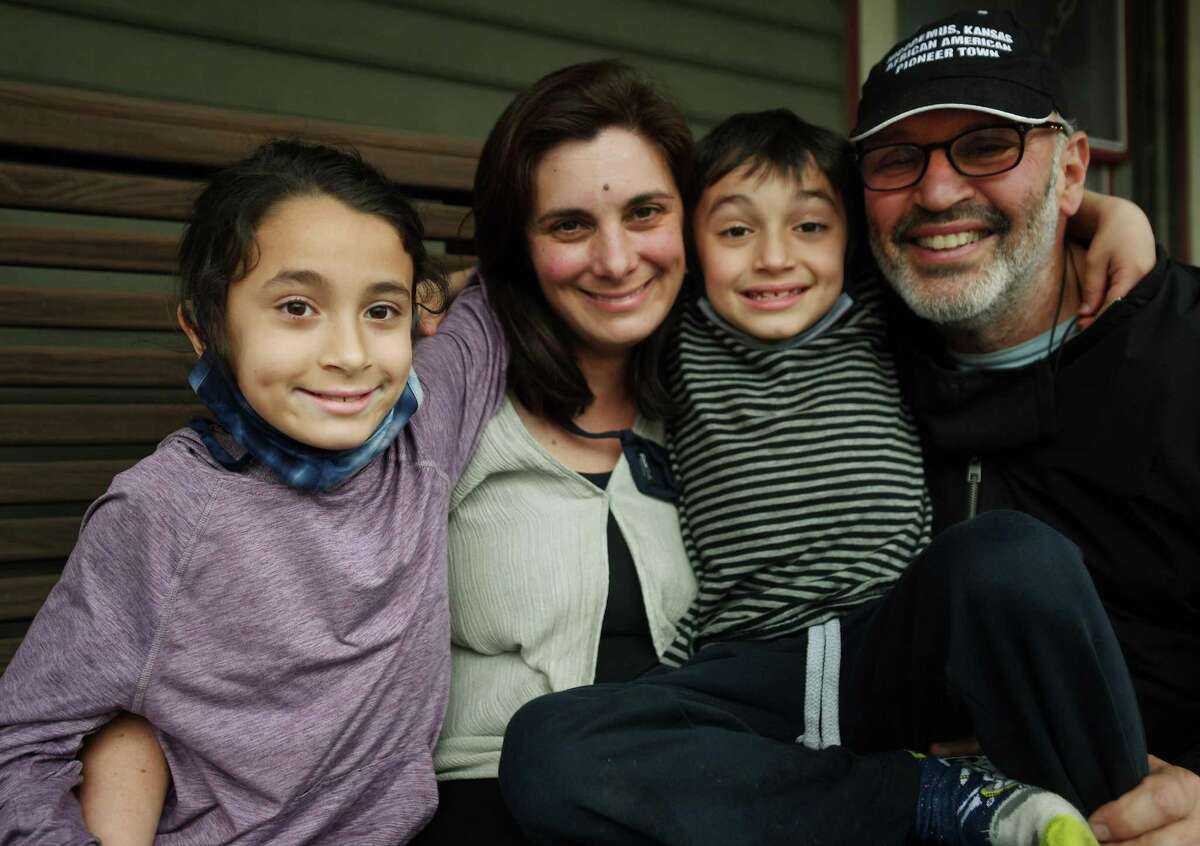 Sarah Miller, second from left, and Lee Cruz of New Haven, with their children Pablo, left, and Mateo, March 31, 2021.
