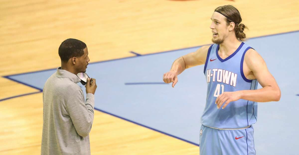 Houston Rockets forward Kelly Olynyk (41) talks to head coach Stephen Silas during the fourth quarter of an NBA game Sunday, May 2, 2021, at the Toyota Center in Houston.