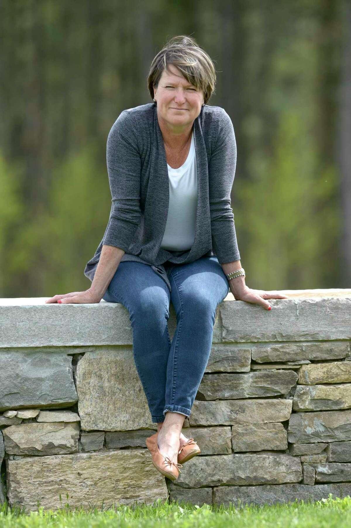 Jennifer Hubbard sits in the Catherine Violet Hubbard Animal Sanctuary. Hubbard has written a book,