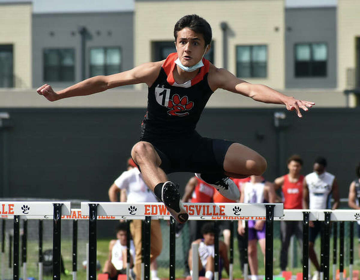 Edwardsville's Chase West competes in the 110-meter hurdles at the Winston Brown Invitational on Friday in Edwardsville.
