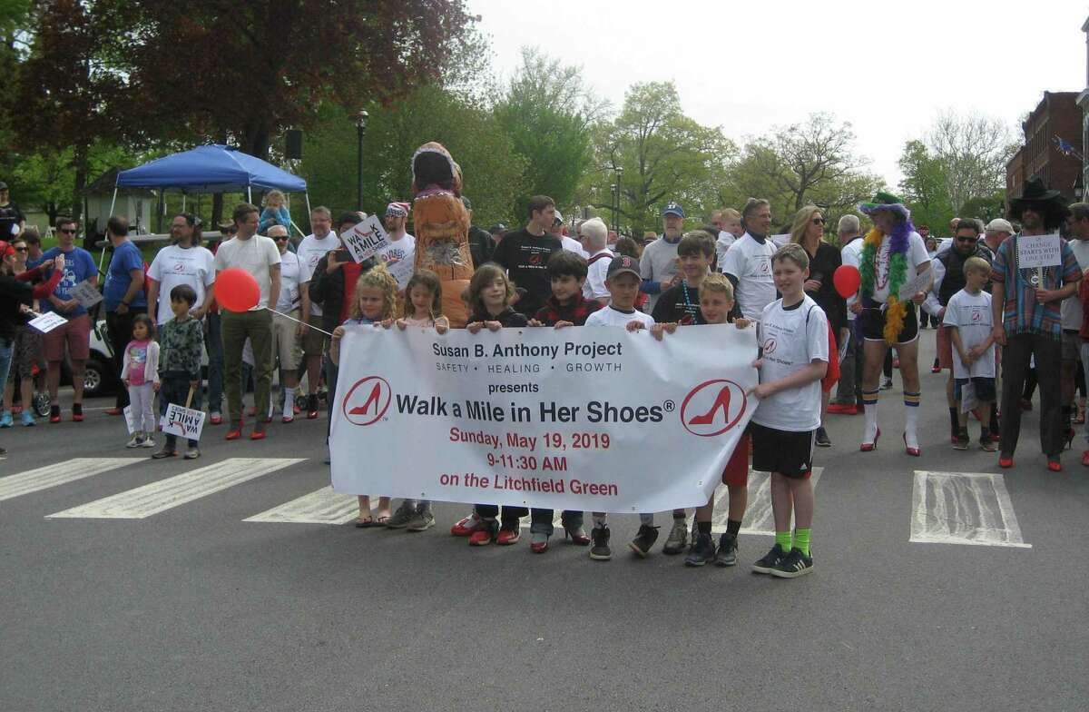 A group of children lead participants of the Walk a Mile in Her Shoes fundraiser and awareness event,held Sunday, May 19, 2019 on the Litchfield Green. This year's walk is virtual and starts May 17; teams and individuals are encouraged to sign up now.