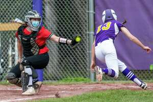 Ballston Spa baserunner Erin Anderson avoids the tag by Guilderland catcher Jess Serravillo during a Suburban Council matchup at Ballston Spa High School on Friday, May 7, 2021. (Jim Franco Special to the Times Union)