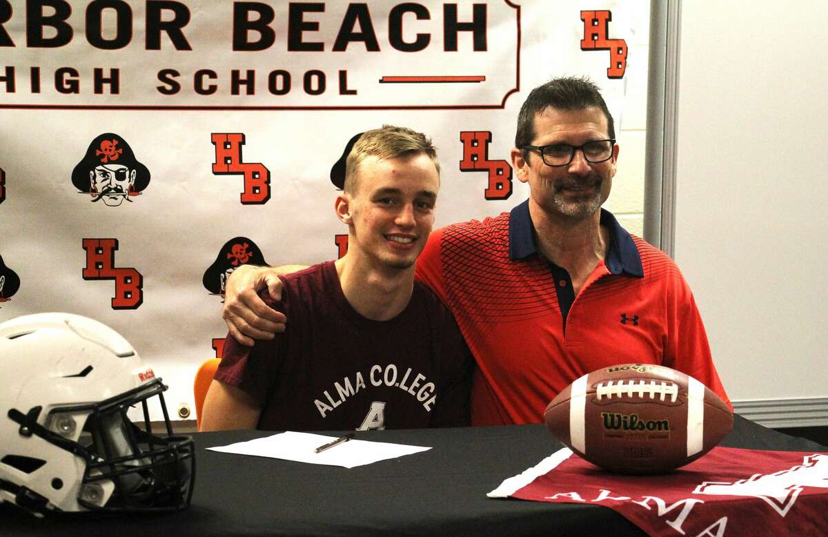 Harbor Beach senior Dylan Kadar, front row, center, signed a letter of intent on Friday morning to attend and play football at Alma College.