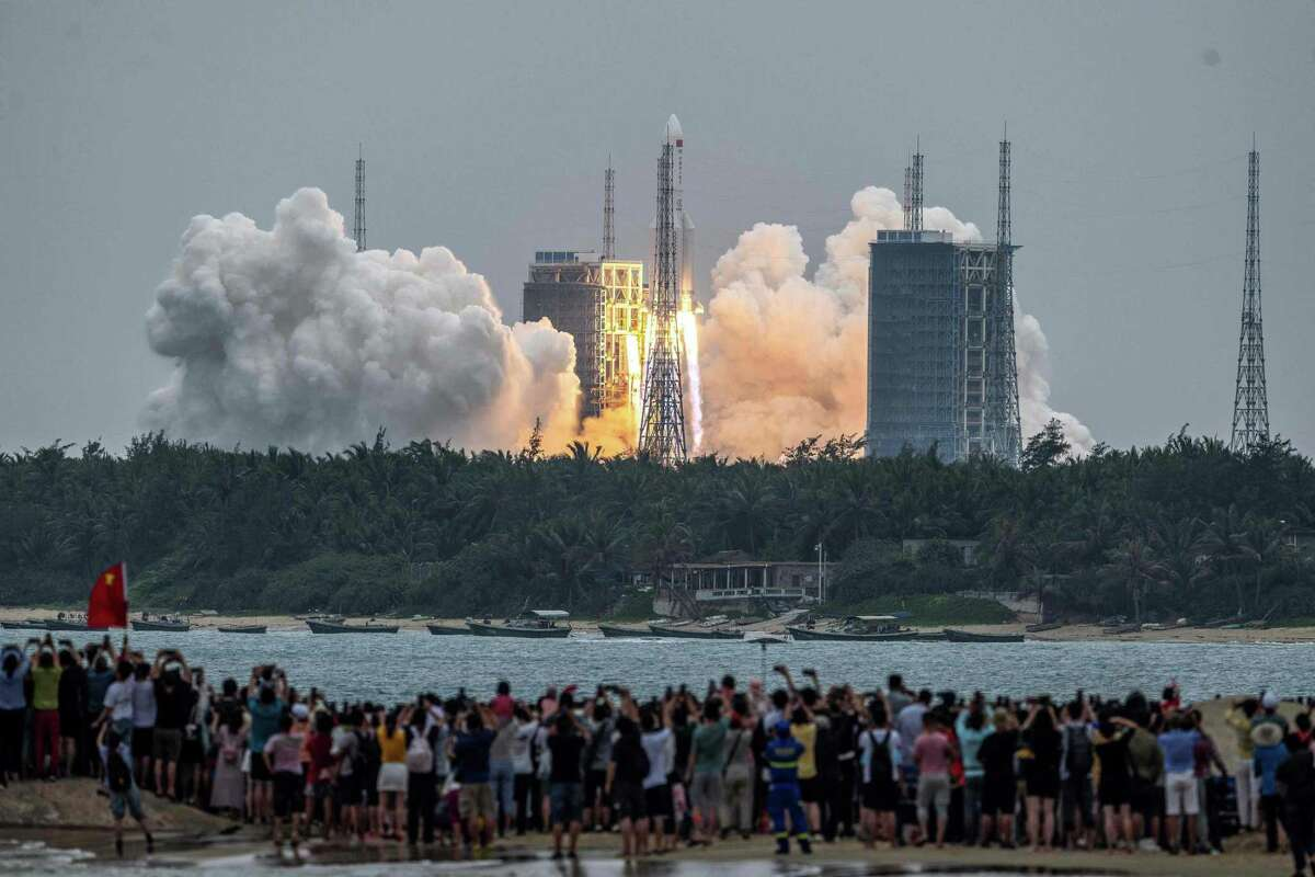 A rocket booster from the Long March CZ-5B, shown blasting off April 29 in southern China, could come back to Earth today.