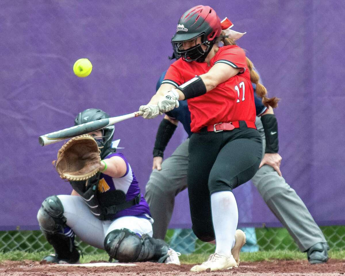 Guilderland senior Irene Dill hits the back end of back-to-back home runs during a Suburban Council matchup against Ballston Spa at Ballston Spa High School on Friday, May 7, 2021. (Jim Franco Special to the Times Union)
