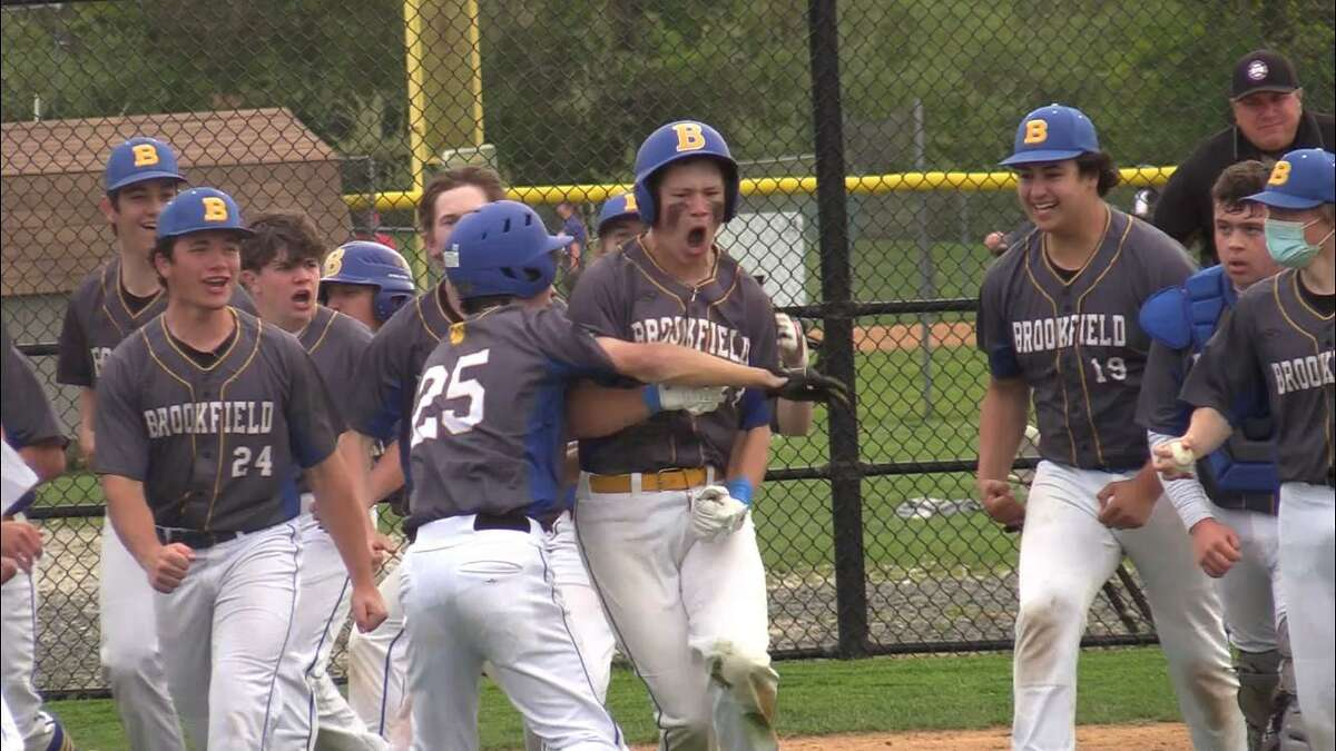 Brookfield's Sam Weigel (23) celebrates with teammates after hitting a grand slam against New Fairfield on Friday.