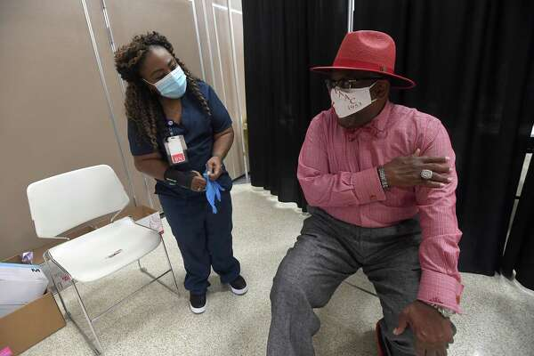 Port Arthur Mayor Thurman Bartie gets his second coronavirus vaccination from nurse LaTasha Mayon at the Civic Center Monday. Photo made Monday, April 5, 2021 Kim Brent/The Enterprise