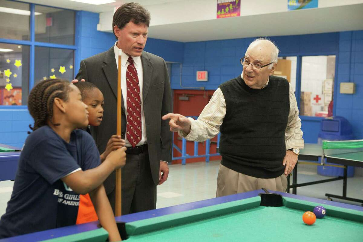 IMAGE DISTRIBUTED FOR BOYS & GIRLS CLUBS OF AMERICA - Sen. John Fonfara (D-Connecticut) , center, and Joseph Lapenta, right, the 2013 Maytag Dependable Leader Award Recipient watch a game of pool on Wednesday, Sept. 25, 2013 at Boys & Girls Clubs of Hartford in Hartford, Conn. (Michelle McLoughlin/AP Images for Boys & Girls Clubs of America)