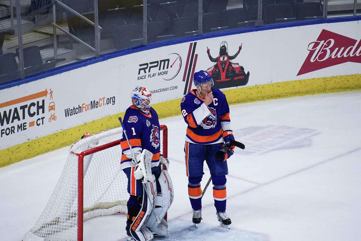 Bridgeport Sound Tigers' goalie Cory Schneider (1) and Seth Hegelson (2) talk during a break in the action against the Providence Bruins during an AHL hockey game on March 31, 2021 at Webster Bank Arena in Bridgeport, Conn.