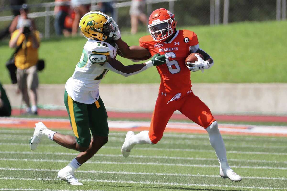 Sam Houston State running back Noah Smith (6) battles with North Dakota State safety Dom Jones (10) for extra yardage as he runs around the end during the third quarter of a quarterfinal game in the NCAA FCS football playoffs on Sunday, May 2, 2021, in Huntsville. Sam Houston advanced to the semifinals with a 24-20 win.