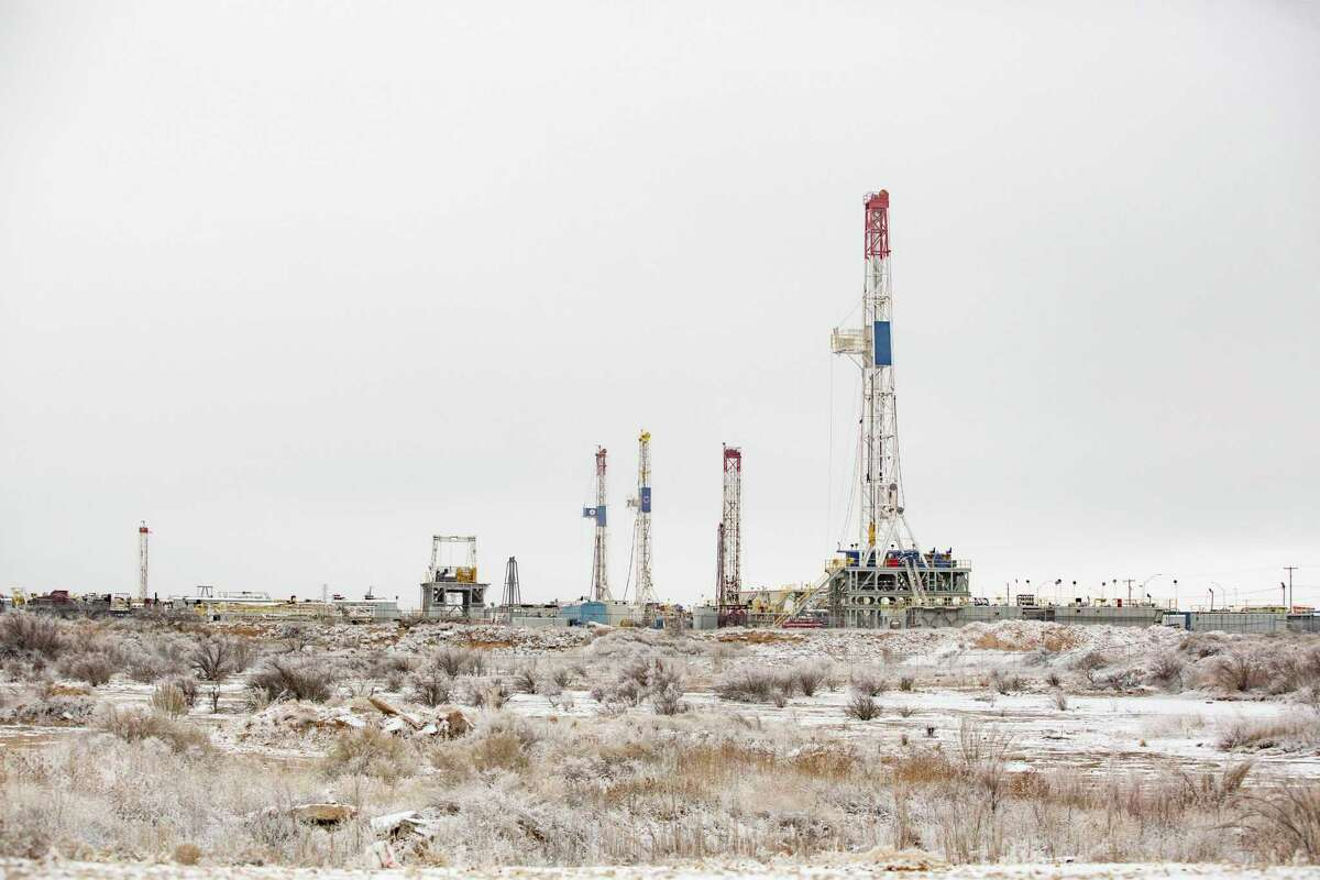 Drilling rigs are seen in a icy landscape in the Permian Basin during the frigig Februray weather. ERCOT forced dozens of natural gas facilites offline during winter storm.
