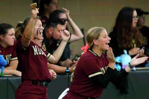 Magnolia West players cheer during a game last week against Dayton.
