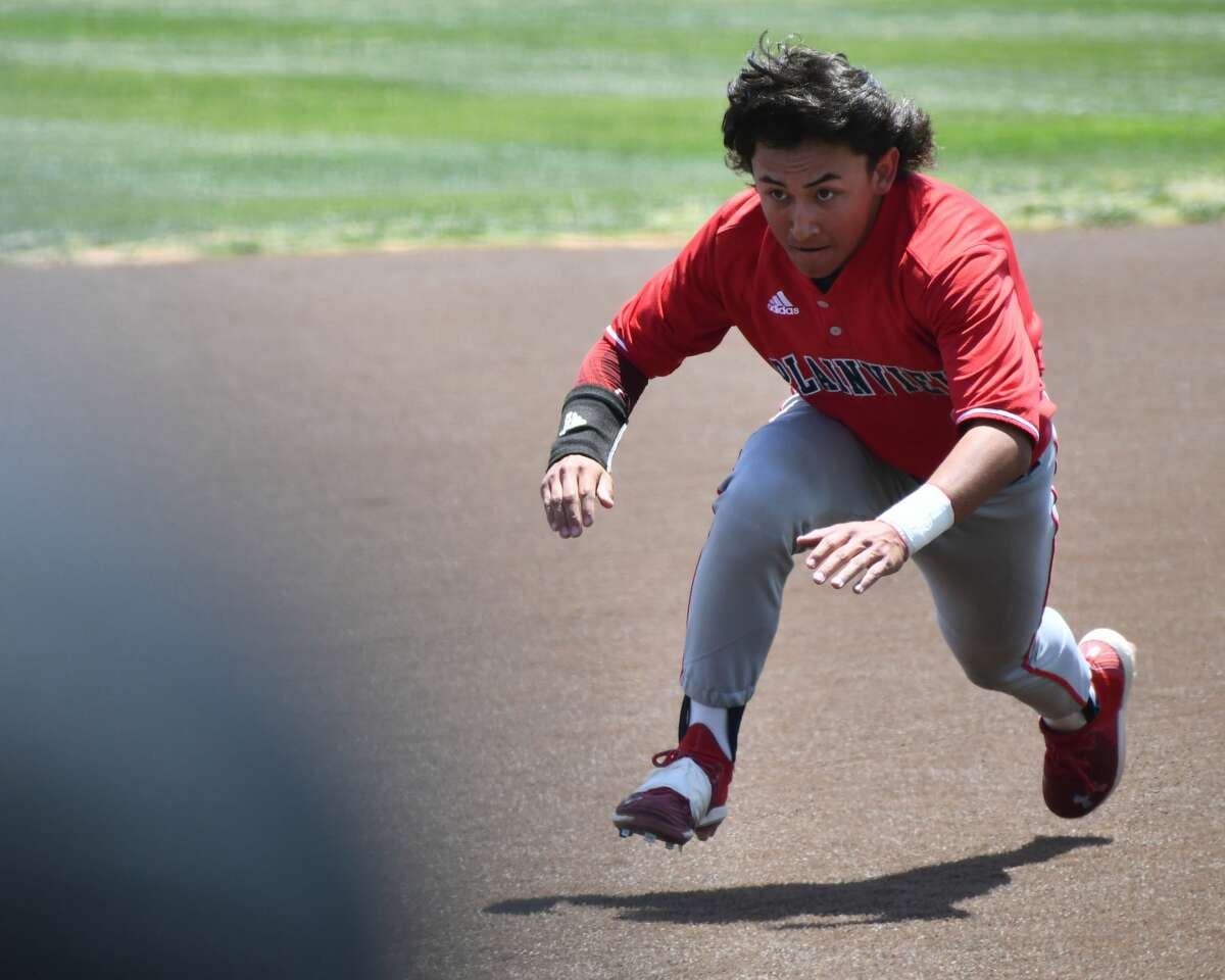 Plainview's Devin Rogers dives into third base during the first game of a Class 5A UIL bi-district baseball playoff game against Abilene Wylie on Friday at Lamesa.