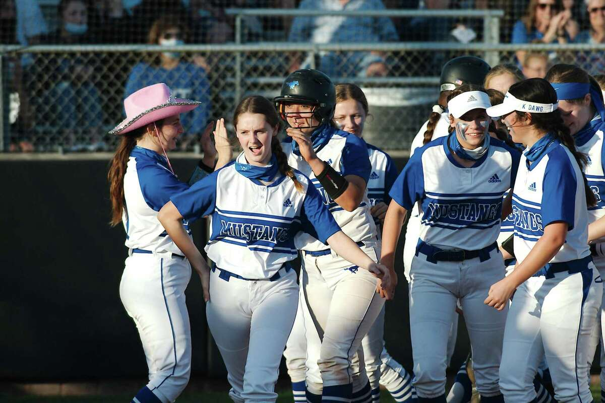 Friendswood's KK Esparza (10) is swarmed by teammates after hitting a home run against Lamar Consolidated Friday at Friendswood High School.
